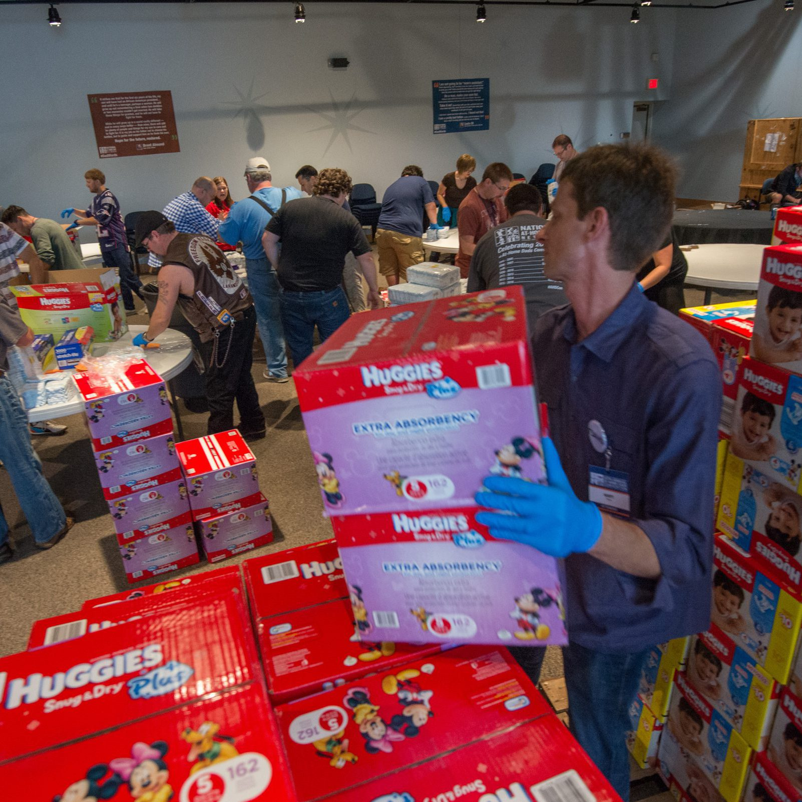 At-Home Dads help sort donations for local diaper banks, in a Community Service activity sponsored by Huggies.